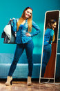 Fashion Woman Wearing Blue Denim In Front Of Mirror Royalty Free Stock Image - 53080196