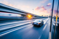 Car Driving On Freeway At Sunset, Motion Blur Stock Photography - 53081272
