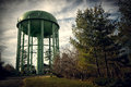 Tall Green Old Water Tower Stock Photography - 53084762