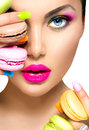 Girl Taking Colorful Macaroons Stock Photography - 53133962