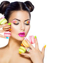 Model Girl Taking Colorful Macaroons Royalty Free Stock Photos - 53135848
