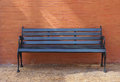 Black Painted Timber Bench With Brick Wall Background Royalty Free Stock Photo - 53154245