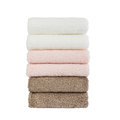 Stack Of Colorful Bath Towels. Isolated Over White Stock Photos - 53164363