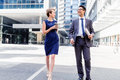 Two Colleagues Walking Together In A City Stock Images - 53177134