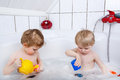 Twins Having Fun And Playing With Water By Taking Bath In Bathtu Royalty Free Stock Image - 53218166