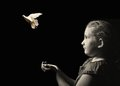 The Little Girl Releasing A White Dove From Hands. Royalty Free Stock Photos - 53243548