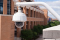 Video Security Camera Housing Mounted High On College Campus Stock Images - 53323754
