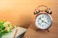 Alarm Clock And Book With Pencil On Wooden Table Royalty Free Stock Image - 53327326
