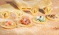 Raw Dough And Italian Homemade Tortellini,open And Closed,filled With Ricotta Cheese,shrimp,prosciutto,fresh Spinach And Walnuts. Stock Image - 53344851