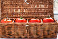 Four Tomatoes In Wicker Retro Box Stock Photography - 53346002