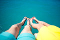 Couple S Legs In Slippers On The Sea Background Stock Photo - 53352330