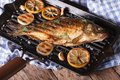 Grilled Fish Carp With Lemon  On A Frying Pan Grill, Horizontal Stock Photography - 53352562