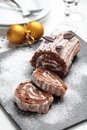 Yule Log Cake On A Christmas Table Royalty Free Stock Photography - 53357317