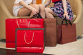 Close Up, Two Pairs Of Female Legs With Shopping Bags Stock Photography - 53359702