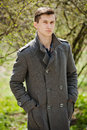 Young Man In A Gray Coat Stock Photo - 53359750