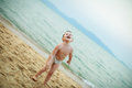 Boy Playing On The Beach Stock Images - 53363724