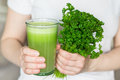 Glass Of Fresh Juice And A Bunch Of Parsley Stock Photo - 53376300
