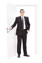 Young Businessman Posing In Front Of A Door Stock Photography - 53387592