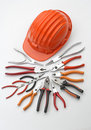 Hard Hat With Pliers And Tongs Royalty Free Stock Photo - 5341865