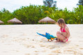 Adorable Little Girl At Beach With Colorful Parrot Royalty Free Stock Photography - 53404417