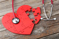 Red Puzzle Heart Stock Photo - 53424790