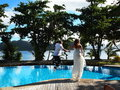 Trash The Dress Leap Into Pool Stock Photos - 53437123