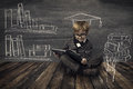 Child Little Boy In Glasses Reading Book Over School Black Board Stock Image - 53439061