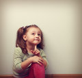 Fun Thinking Kid Girl Sitting In Pink Jeans And Looking Up Royalty Free Stock Photography - 53441827