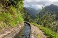 Levada, Irrigation Canal With Hiking Path At Madeira Island, Portugal Stock Photo - 53445800