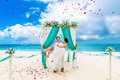 Wedding Ceremony On A Tropical Beach In Blue. Happy Groom And Br Royalty Free Stock Photos - 53463738