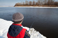 Boy Fishing With Rod On River In Winter. Stock Image - 53476351