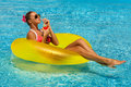 Sexy Woman In Bikini Enjoying Summer Sun And Tanning During Holidays In Pool With A Cocktail Stock Photo - 53495140