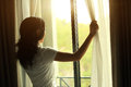 Young Woman Open Window Royalty Free Stock Photos - 53512048