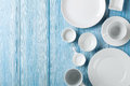 Empty Plates And Bowls On Blue Wooden Background Stock Photography - 53513302