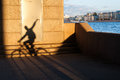 The Long Shadow Of A Cyclist Stock Photo - 53523470
