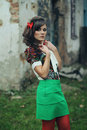 Girl Green Skirt And Red Tights Stock Photography - 53524772