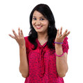 Happy Young Woman Gesturing An Open Hands Stock Photography - 53534192