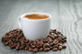 Cup Of Fresh Espresso With Coffee Beans On Oak Stock Images - 53538014
