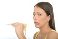 Natural Cautious Young Woman Holding A Fork Full Of Cooked Spaghetti Pasta Stock Photography - 53539222