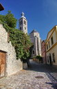 Photo Of The Old Narrow Cobblestone (natural Stone) Streets Of Medieval European Small Town, Going To An Ancient Catholic Church. Stock Photos - 53542693