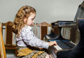 Cute Little Girl Playing Grand Piano In Music School Royalty Free Stock Image - 53554976