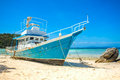Old Fishing Boat Stranded On A Beach Royalty Free Stock Photo - 53562115
