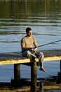 Man Fishing On A Dock Stock Image - 5367521