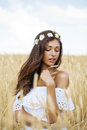 Young Woman In A Wheat Golden Field Royalty Free Stock Images - 53629589