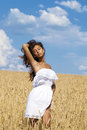 Young Woman In A Wheat Golden Field Royalty Free Stock Images - 53629629