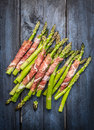 Fresh Young Asparagus Wrapped In Prosciutto Meat On Rustic Blue Wooden Background Royalty Free Stock Image - 53630536
