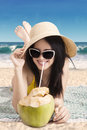 Woman Drink Coconut Cocktail At Coast Stock Images - 53644954