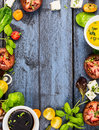 Salad Making, Food Frame With Oil,vinegar, Tomatoes, Basil And Cheese On Blue Rustic Wooden Background, Top View Stock Photo - 53648280