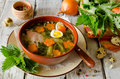 Nettle Soup With Eggs And Carrot In The Bowl On The Table Royalty Free Stock Image - 53692306