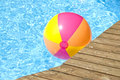 Beach Ball Floating In The Pool Royalty Free Stock Photo - 5377035